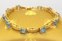 Blue Topaz Bracelet in Gold, 7.25in