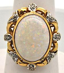 LADIES 14 KT GOLD OPAL AND DIAMOND RING.