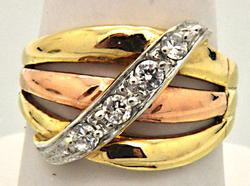 LADIES 14 KT YELLOW AND ROSE GOLD DIAMOND BAND.