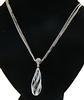Amazing Blue Topaz and Diamond Swirl Pendant Necklace