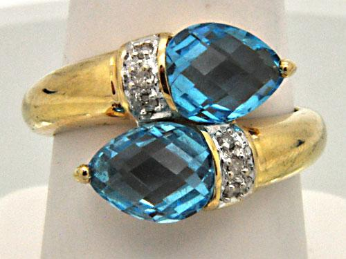 LADIES 14 KT YELLOW GOLD BLUE TOPAZ AND DIAMOND RING.