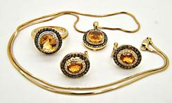 14 KT YELLOW GOLD LEVIAN SET WITH CITRINE AND DIAMONDS.
