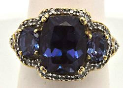 10 KT PURPLE/BLUE AND DIAMOND GEM RING.