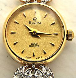 LADIES 14 KT GOLD AND DIAMOND ELGIN WATCH.