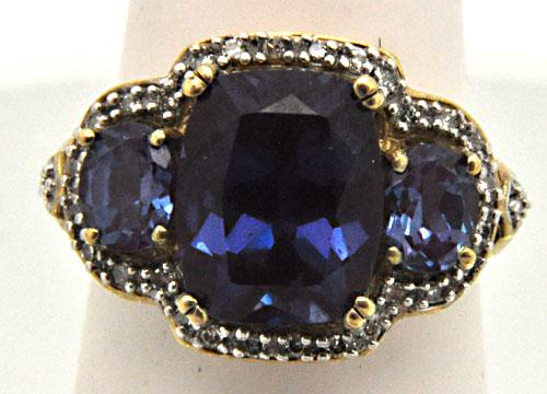 10 KT PURPLE/BLUE AND DIAMOND GEM RING.