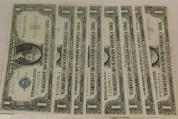 8 Notes: 1957-A and -B  $1 Silver Certificates, Gem Unc
