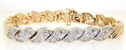 Elegant Tow Tone Gold Bracelet Containing Fifty Six Prong Set Diamonds