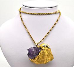 18 KT YELLOW GOLD AMETHYST, DIAMOND PENDANT ON THE 14 K