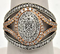 14 KT WHITE AND ROSE GOLD OPENWORK DIAMOND RING.