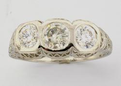 Gorgeous Three Stone PlatinumDiamond Ring, .90CTW