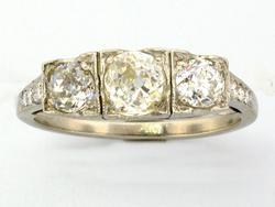 .75 CTW Diamond Three Stone Ring in 18KT