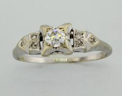 White Gold Filligree Ring with .25 CTW Diamonds