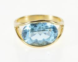 14K Yellow Gold Oval Blue Topaz Pressure Illusion Set Ring