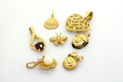 Lot of 7 Gold Pendants