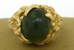 Dark Green Cabochon Ring with Flower Motif in Gold