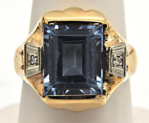 LADIES BLUE TOPAZ AND DIAMOND RING.