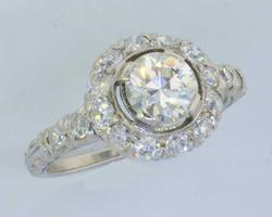 Beauty VS .68CT Diamond in Platinum Diamond Halo