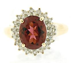 Elegant Pink Tourmaline and Diamond Halo Ring