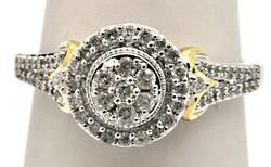 14KT WHITE GOLD DIAMOND RING WITH YELLOW GOLD ACCENTS.