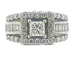 Amazing Princess Cut Center w Halo Bagg Diamond Ring