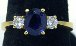 1.37CT Sapphire & 0.25CTW Diamond Ring in 18KT Gold