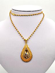 23KT GOLD BEAD NECKLACE WITH A 21KT PENDANT.