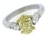 Remarkable Fancy Intense w Pear Shaped Side Diamonds