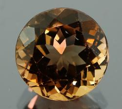 Fiery 6.40ct heavy flashing Topaz solitaire