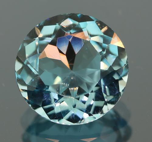 Fiery 8.47ct heavy flashing Topaz solitaire