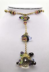 18KT YELLOW GOLD MIXED GEMSTONE BRIOLETTE NECKLACE.