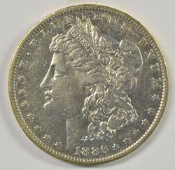 Better date 1886-O Morgan Silver Dollar in AU