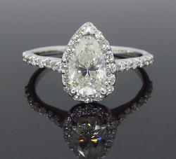 Halo Style Pear Cut Diamond Engagement Ring