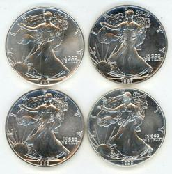 4 Superb Gem BU 1986, 87, 88, & 1999 $1 Silver Eagles
