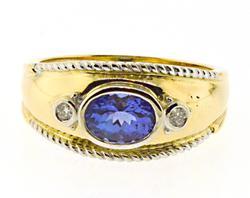 Beautiful Bezel Set Oval Tanzanite and Diamond Ring