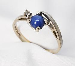 Fascinating  Linde Star Sapphire Ring in 10K WG