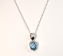 Fashionable Blue Topaz & Diamond Pendant