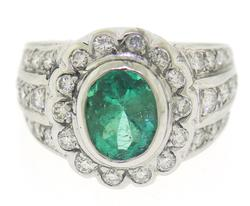 Glowing 18kt Oval Cut Emerald and Diamond Ring
