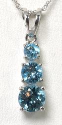 Blue Topaz Pendant & Chain in White Gold