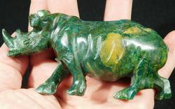 Sizable deep green 1,075ct Verdite carving