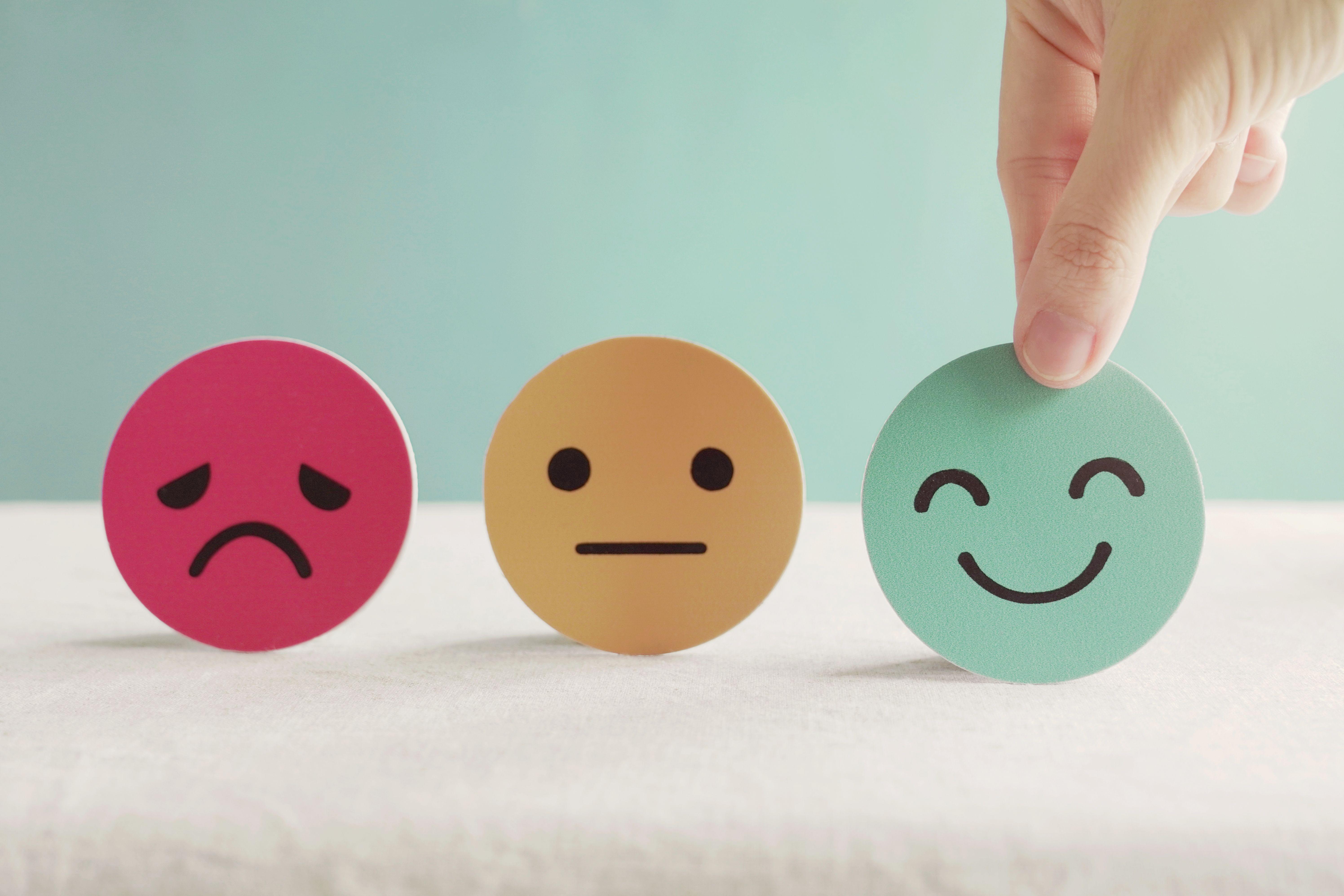 hand-choosing-happy-face.jpg