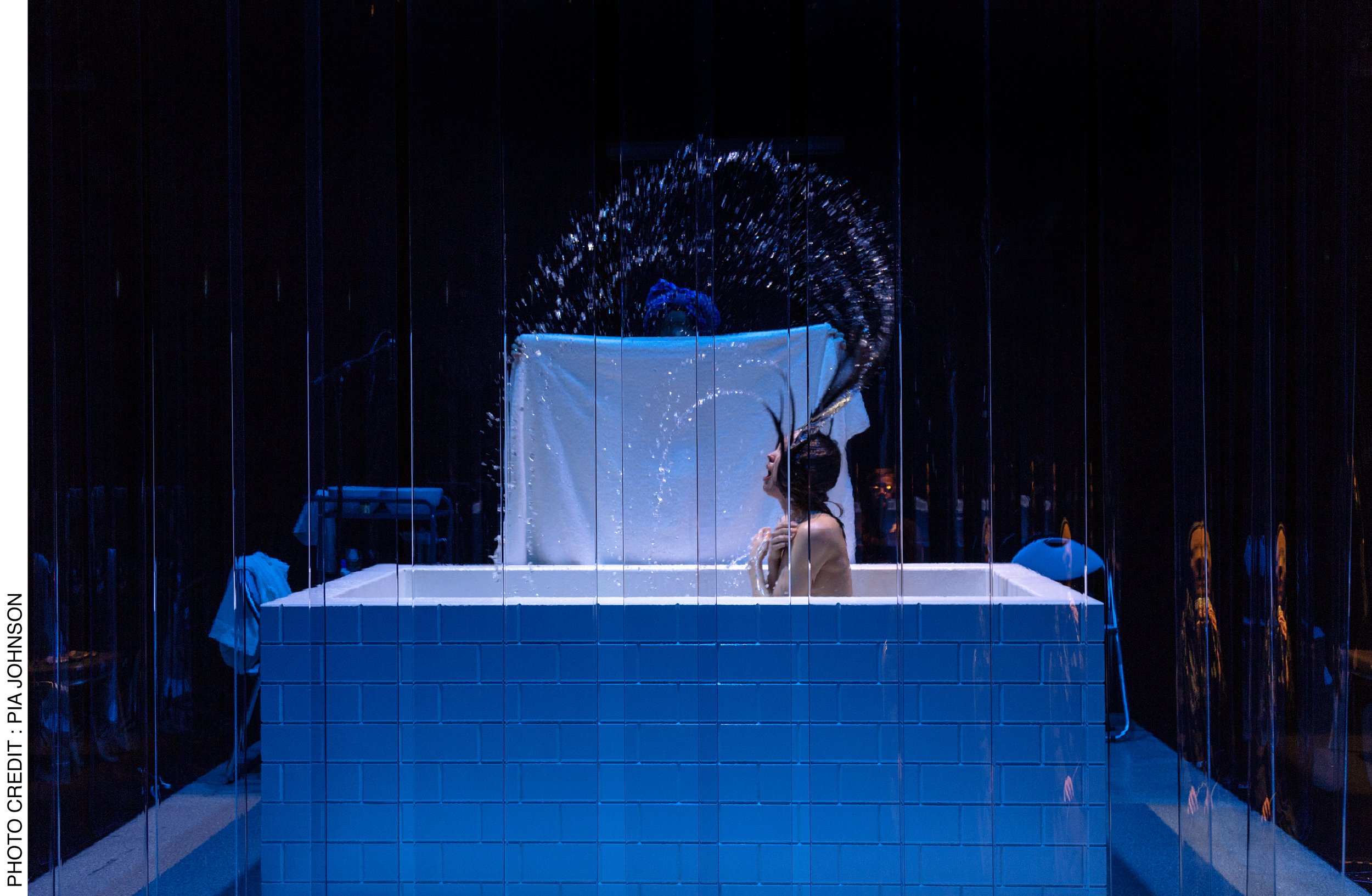 <p>Act 2 of <i>Dybbuks </i>and the mikvah scene. Lauren Langlois throws back her head as water from the ritual bath is flung against the perspex curtain, towards the audience.  Photo Credit: Pia&nbsp;Johnson</p>
