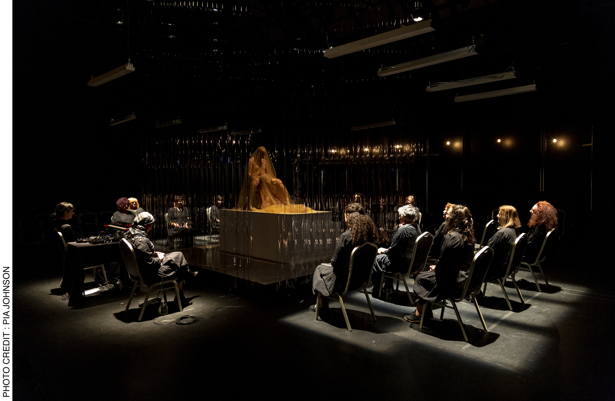 <p>The choir and musicians, including Carolyn Schofield on electronics and voice artist Jenny Barnes, surround performers Lauren Langlois and Yoni Prior on the central raised platform of the stage.  Photo Credit: Pia&nbsp;Johnson.</p>