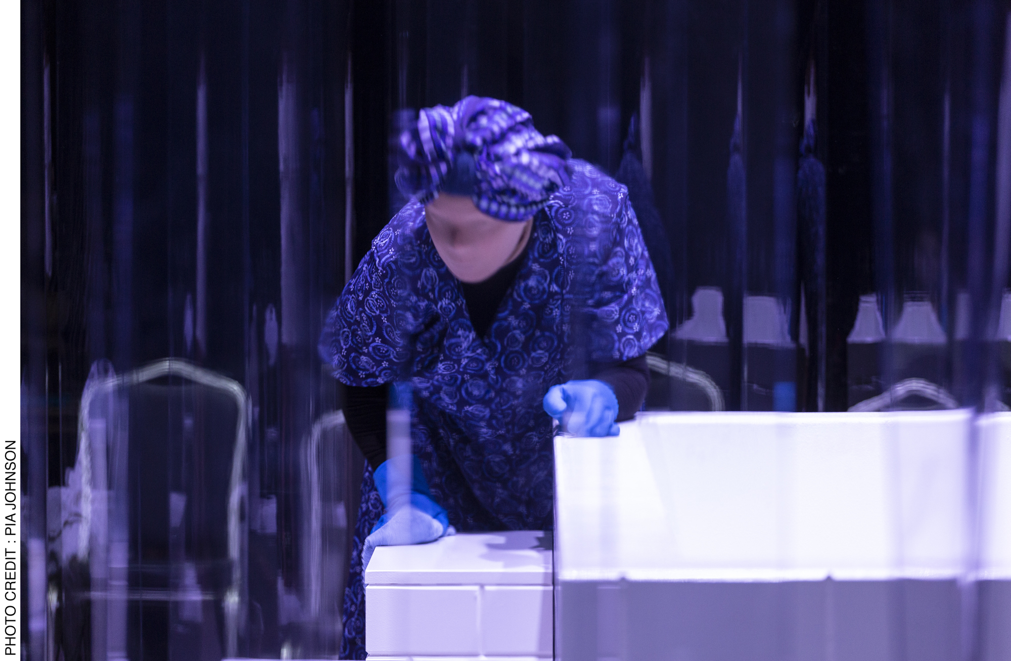 <p>Yoni Prior in Act 2, faceless, meticulously and rhythmically cleans the tiles around the mikvah. Photo Credit: Pia&nbsp;Johnson.</p>