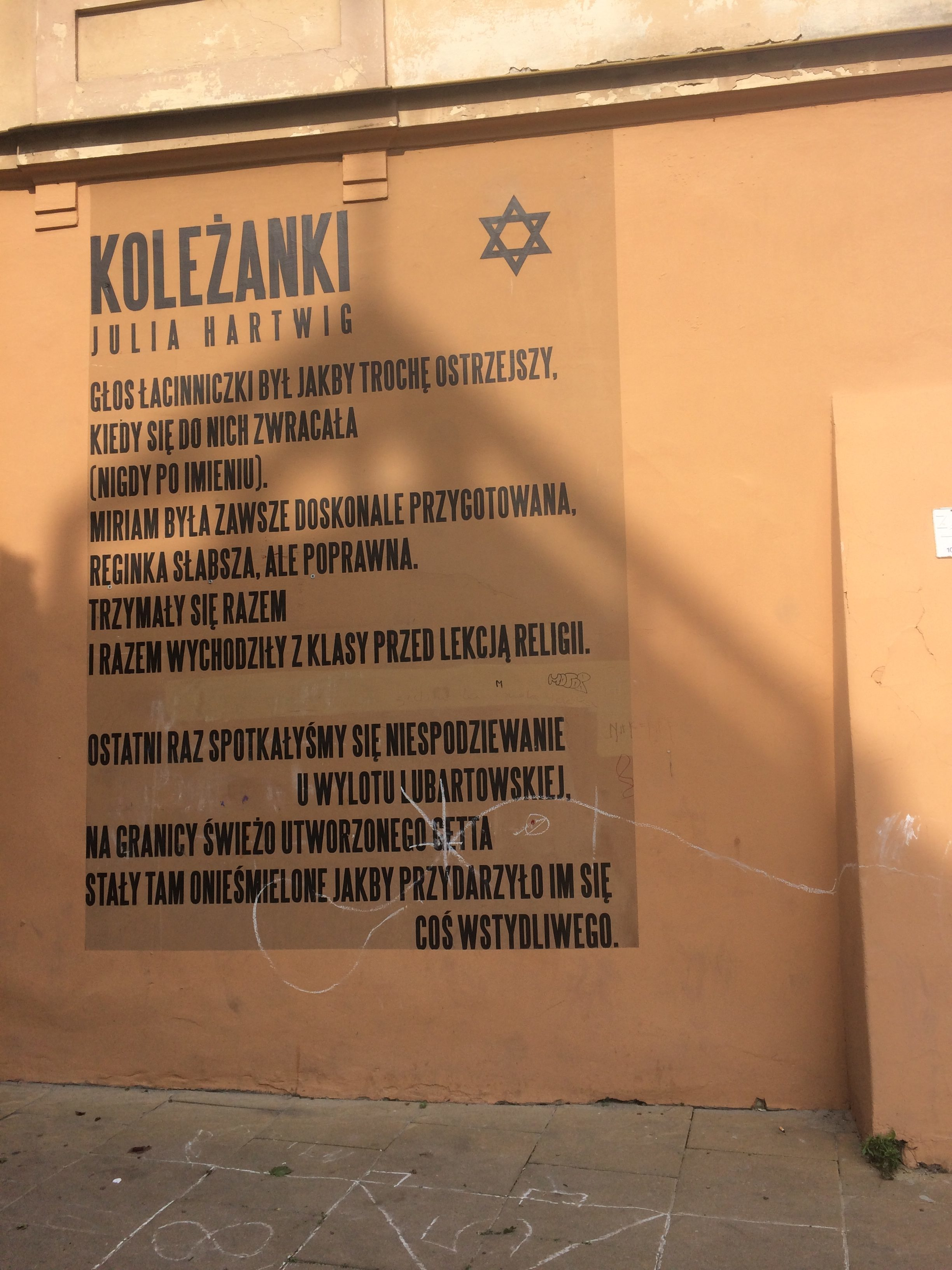 "<p>Poem on the side of a&nbsp;build­ing in Lublin by Julia Hartwig (""Class­mates"") For more infor­ma­tion and an Eng­lish trans­la­tion, see <a href=""https://teatrnn.pl/pamiec/en/1/"">the The­ater <span class=""caps"">NN</span>'s web­site.</a> Pho­to by the&nbsp;author.</p>"