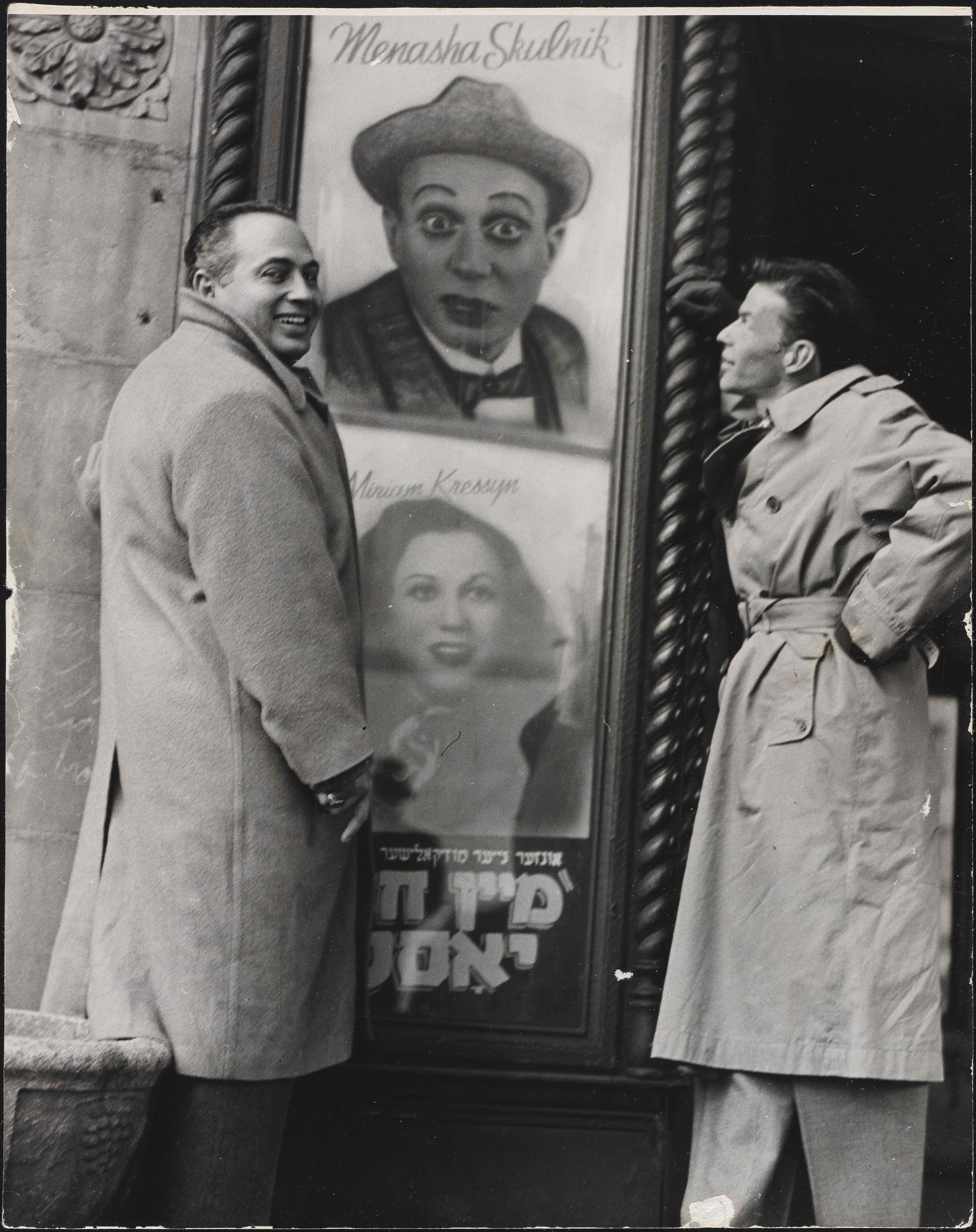 <p>Frank Sinatra (right) and his agent pose with posters of Yiddish stars Menasha Skulnik and Miriam Kressyn outside the Second Avenue Theatre, c. 1943. Museum of the City of New York, Gift of Mrs. Menasha Skulnik, 76.55</p>