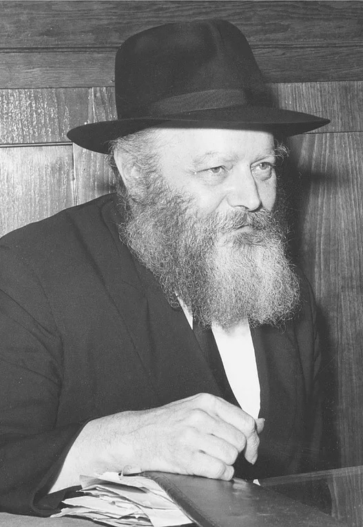 "<p>The Lubav­itch­er Rebbe, R. Men­achem Mendel Schneer­son, pho­tographed in his study, at <span class=""numbers"">770</span> East­ern Pkwy, Brook­lyn, <span class=""caps"">NY</span>, in <span class=""numbers"">1966</span> (cour­tesy of Chabad​.org)</p>"