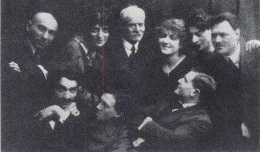 <p>(One of) The Vilna Theater Troupe(s) from 1918 or 1919. From left to right: Standing: Noah Nakhbush, Unknown, Jacob Dineson, Unknown, Sonia Alomis, Unknown, David Hermann. Sitting: Boaz Karlinski, Unknown, Chaim Shneyer. via Wikimedia Commons.<br></p>