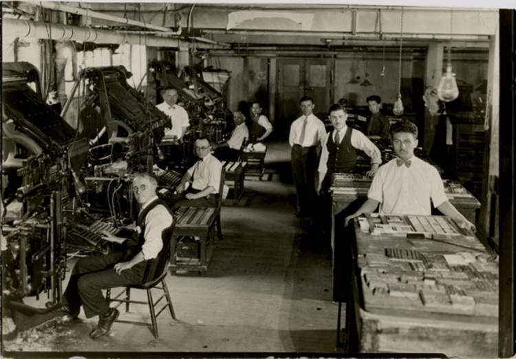 <p>Image of typesetters at work at the <em>Keneder adler</em> printshop, via Jewish Public Library,&nbsp;Montreal</p>