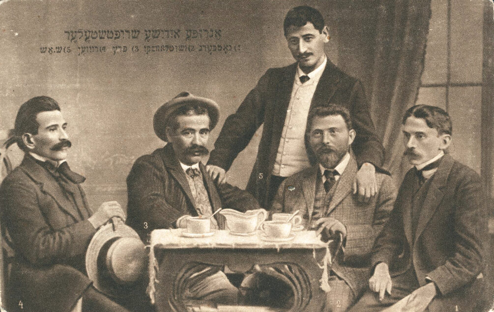 """<p>Zhitlowsky pictured with other Yiddish writers at the Czernowitz Conference in <span class=""""numbers"""">1908</span>. From left to right: Avrom Reyzen, Yitskhok Leybush Peretz, Sholem Asch, Khayim Zhitlovski, Hersh Dovid Nomberg. Postcard (Warsaw: Verlag Jehudia). (<span class=""""caps"""">YIVO</span>)</p>"""