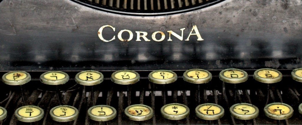 "<p>Image via the <a href=""https://jhsgh.org/corona-xc-r-yiddish-typewriter/"">Jewish Historical Society of Greater&nbsp;Hartford</a></p>"